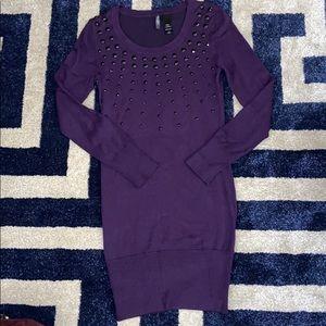 Purple sweater dress with black rhinestones.